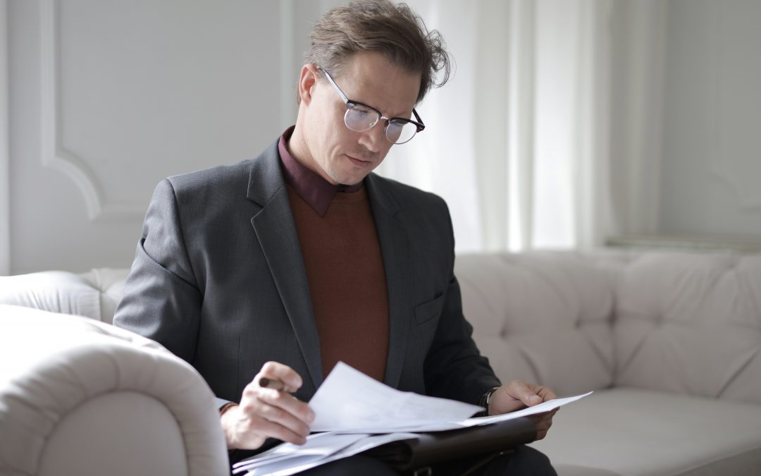 Picture of a male reading 6 Reasons Why Now Is The Time To Review Your Defined Benefit Pension